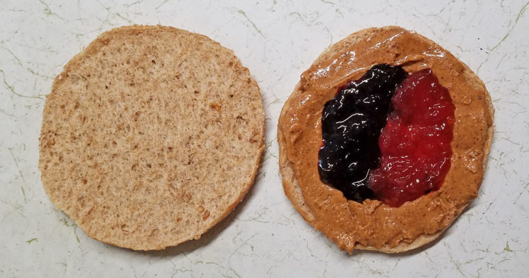 Almond butter and jelly on bread thin
