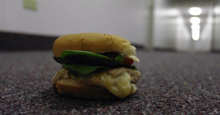 Stuffed Pork Chop on hamburger roll
